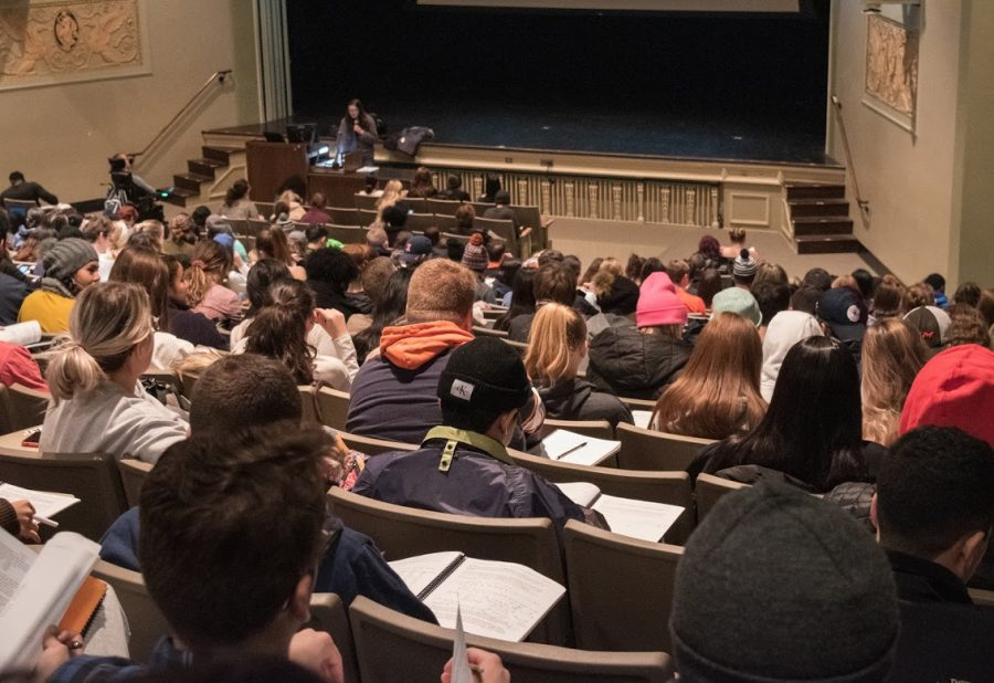 Students in a statistics class listen attentively in a lecture at the Lincoln Hall Theater. Some introductory courses may require meetings with Teacher's Assistain's instead of office hours next year.