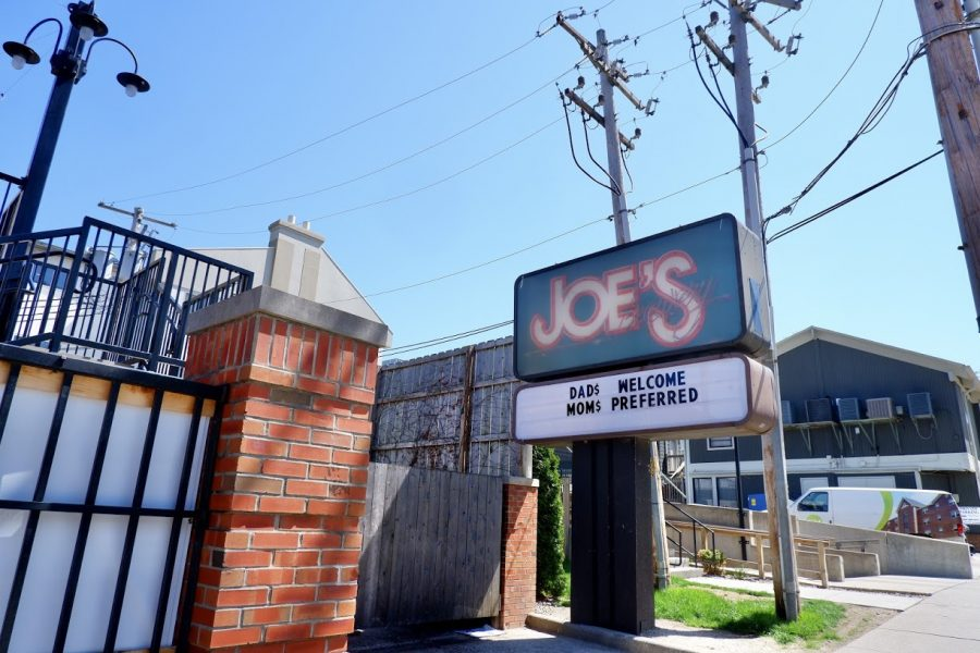 "Joe's Brewery sits quietly on Wednesday afternoon with a letter board sign out front reading ""Dads Welcome Moms Preferred."" Moms Weekend was held from April 9-11, which consisted of many organized virtual events."