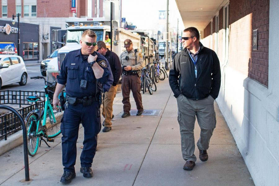 Champaign police officers patrol the Green St. Campustown area on March 31, 2019. The Champaign Unit 4 school board recently voted to re-enlist two school resource officers for the next year.