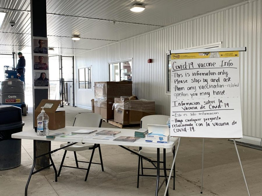 The booth that Lesley Nava and Anthony Erlinger, Pandemic Health Navigators, set up at Rantoul Foods on March 31 is pictured above. The goal was to inform immigrant workers about the COVID-19 vaccine and dispel myths.