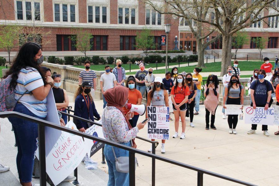 University students protest on the steps of Foellinger auditorium on Wednesday. Unite for Uighur UIUC organized the event to raise awareness for the Uighur Muslims and the abuse they've been facing.