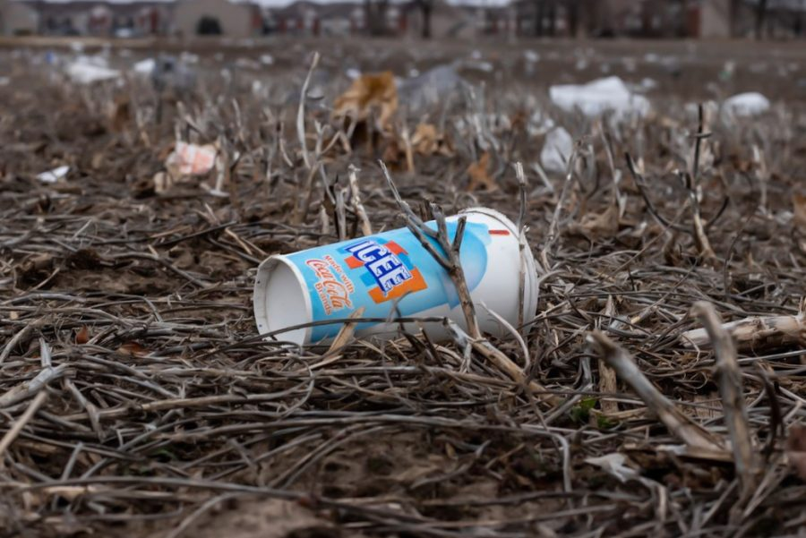 Trash is scattered along an empty field on March 9, 2020. People are unfortunately leaving their trash on the ground instead of throwing out or recycling the item.