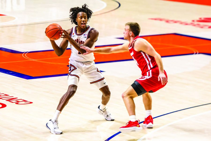 Junior Ayo Dosunmu looks to pass during the game against Wisconsin on Feb. 6. Columnist Matthew believes NCAA players like Dosunmu should be allowed to be compensated with more than just tuition by colleges.
