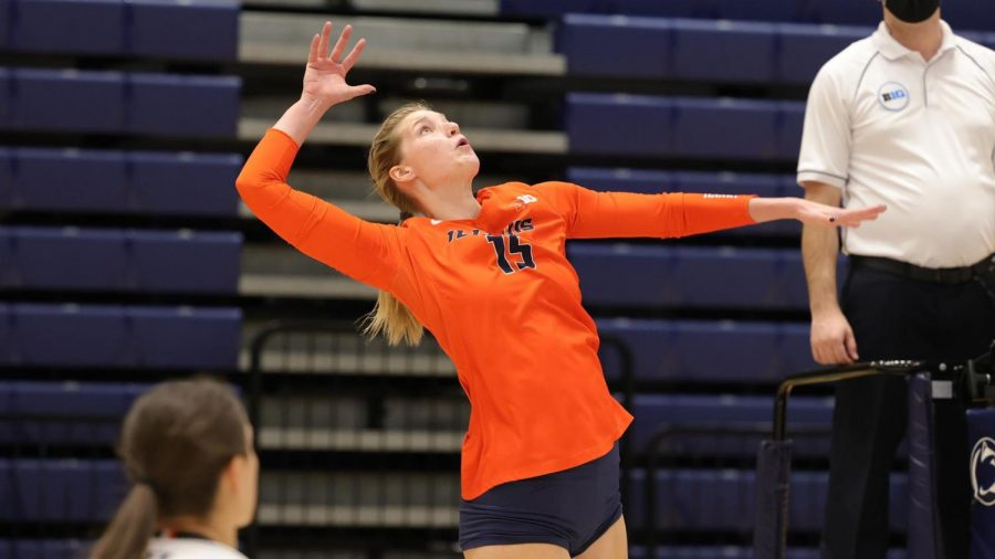 Fighting Illini Athletics Senior Megan Cooney spikes the ball during competition. Cooney will return next year for a fifth season with Illinois volleyball.