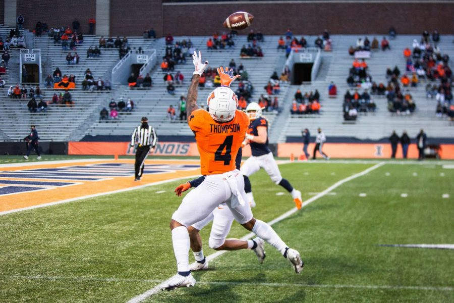Sophomore Khari Thompson leaps to catch the football at the Orange and Blue football game on April 19.