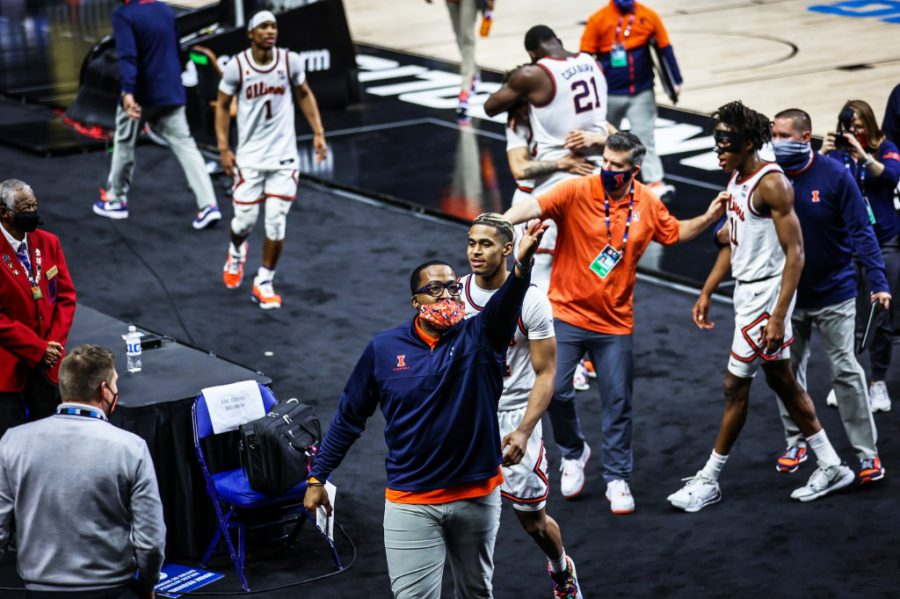 Ron Coleman celebrates a win by hyping the crowd up on March 13 against Iowa.