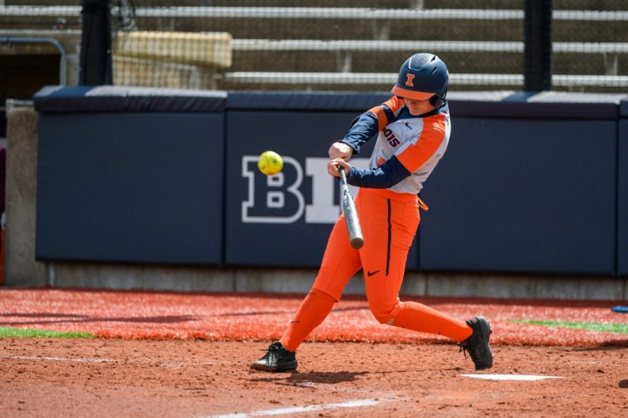 Junior Kailee Powell swings at the ball during their game against Minnesota March 28. Powell has a diverse tool set, as she has played almost every position at some point in her softball career.