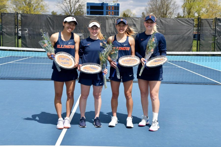 SAsuka Kawai, Mia Rabinowitz, EmileeDuong and Sasha Belaya (left to right) pose for a photo on senior day Sunday. The Illinois women's tennis team won the match 4-3, upsetting No. 7 Northwestern.