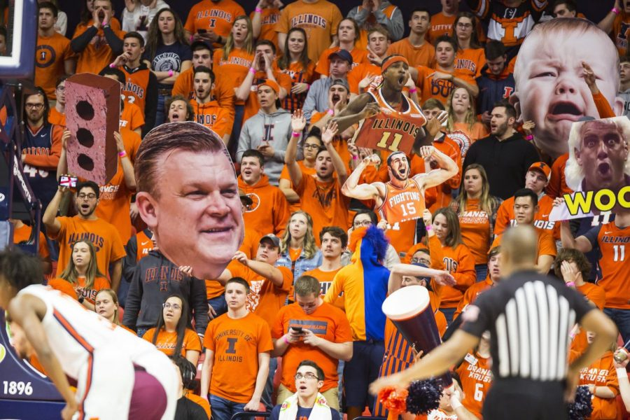 The Orange Krush student section shouts at a game between the Illini men's basketball team and Minnesota at State Farm Center Jan. 30, 2020.