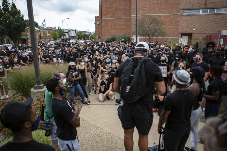 Members of the Illinois football team speak at the Champaign Police Department during a student-led Black Lives Matter march on Aug. 31.