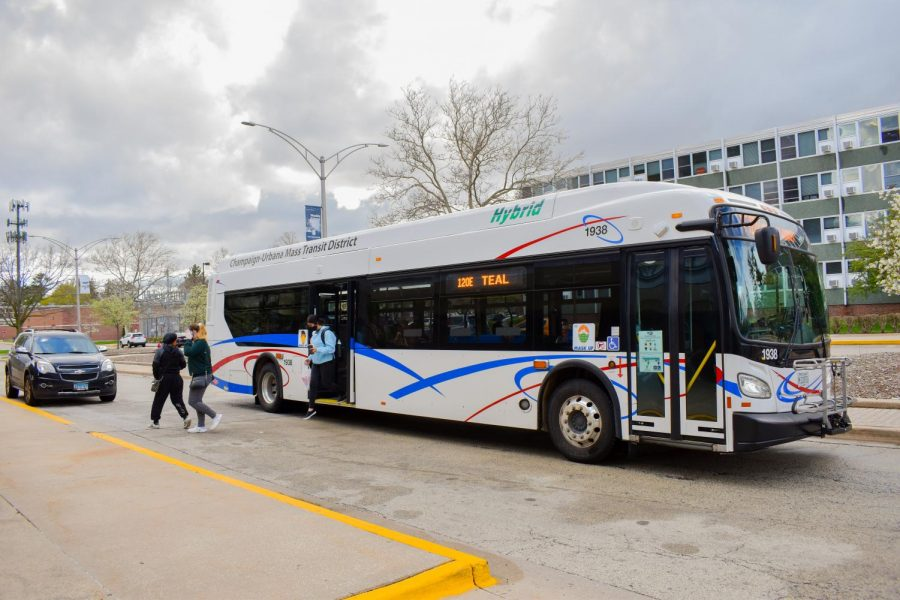 University students exit the Champaign-Urbana Mass Transit District 120 Teal bus outside of the PAR dorm on Saturday. CUMTD will release two hydrogen fuel buses this fall to cut down on carbon emissions.