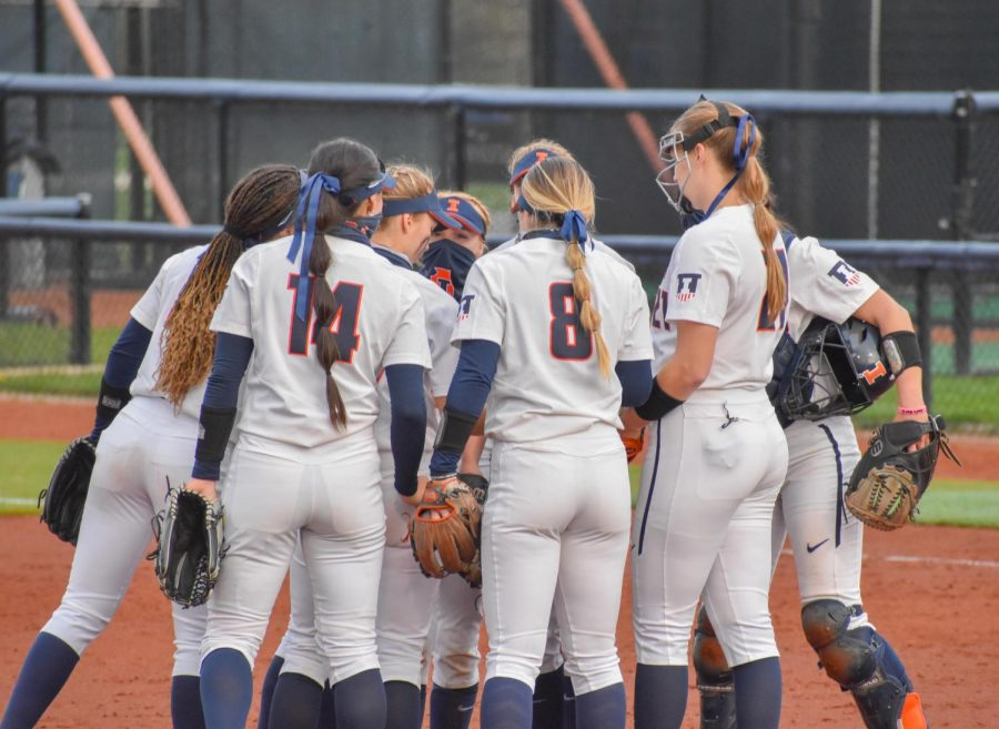 The Fighting Illini softball team huddles up during a game against Purdue on April 16. The team will be playing at Eichelberger Field this weekend against Indiana.