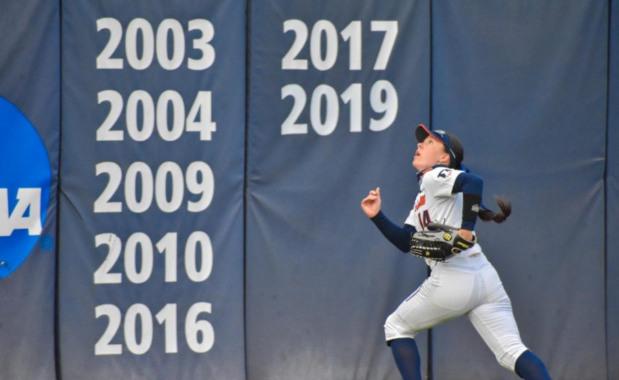 Sophomore Kelly Ryono scans the sky for a ball at a game against Purdue on Friday at Eichelberger Field. The Illinois softball team defeated Purdue in their series this weekend in Urbana, Illinois.