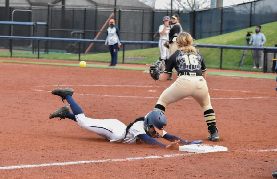 Sophomore Miranda Gallardo slides into third base during a game against Purdue April 16. The Illinois softball team is in Evanston, Illinois this weekend hoping to overtake Northwestern in their four-game series.