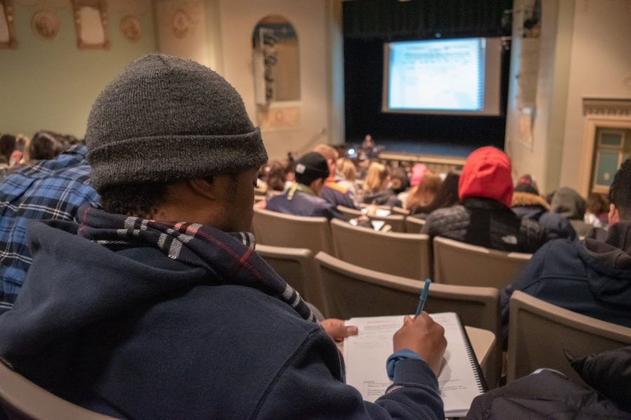 Students in a statistics class listen attentively to a lecture at the Lincoln Hall Theater on December 2, 2019.