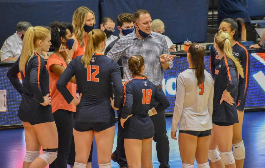 The Illinois volleyball team huddles up for a talk with coach Chris Tamas in a game against Indiana on Saturday. The struggling team will face Purdue in West Lafayette, Indiana on Friday and Saturday.