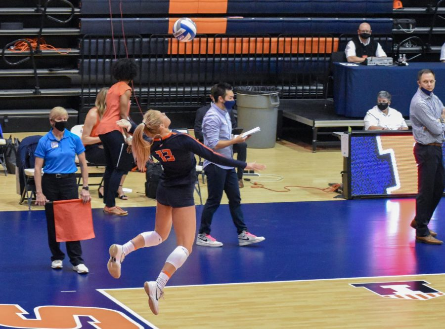 Junior Mica Allison leaps up to complete a serve during the game against Indiana on March 27 at Huff Hall.