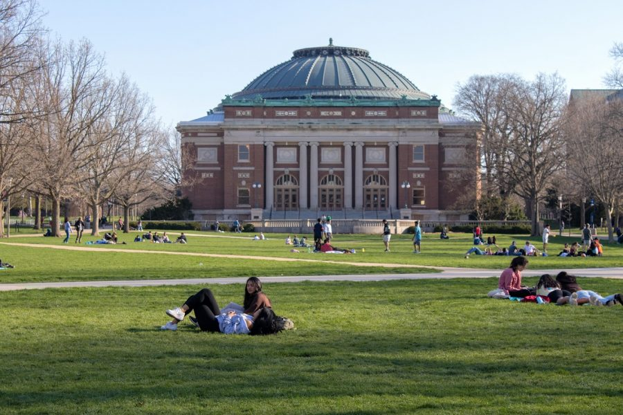 Students sit on the quad enjoying a nice spring day. Students all enjoy the quad no matter their age.