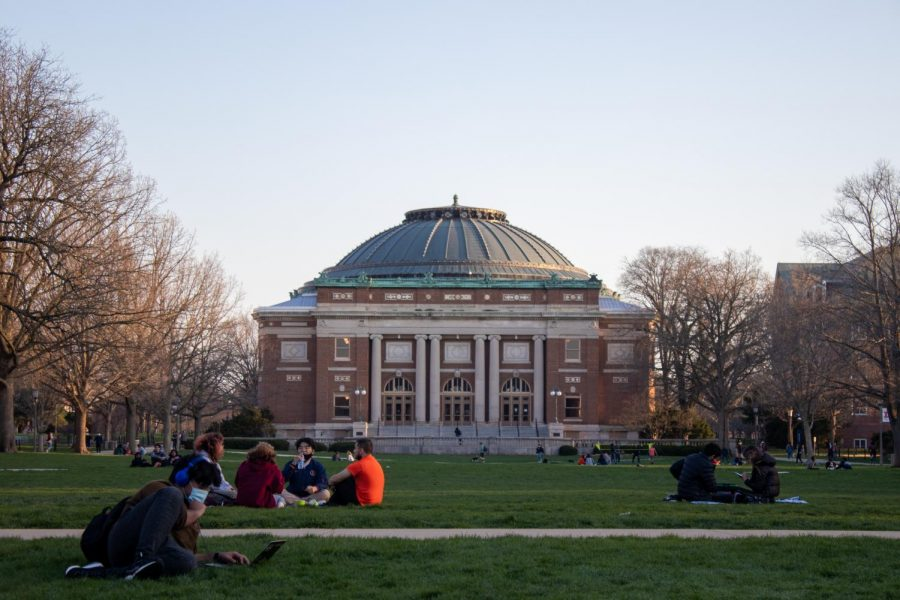 Students sit on the Main Quad April 3. Columnist Andrea Martinez argues that students at the University learn about diversity, but not inclusion — about diverse communities, but not how to interact with them.