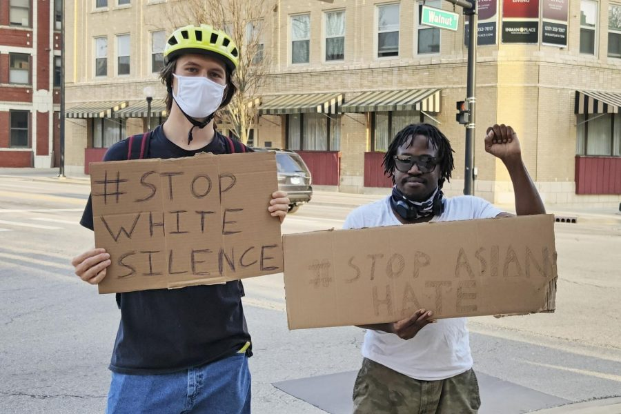 Champaign-Urbana residents Luke Lee and Eddie Pratt Jr. pose for a photo at the #EndWhiteSilence street visibility event in downtown Champaign on Wednesday afternoon. The University's chapter of Showing Up for Racial Justice has organized two rallies thus far to demand racial justice for the Asian American and Pacific Islander community.