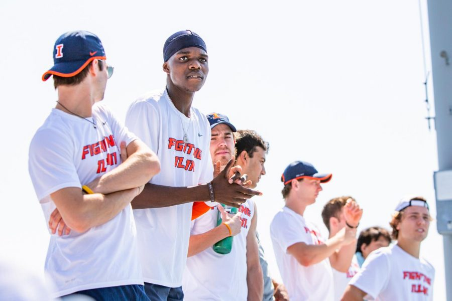 Junior Kweisi Kenyatte and his teammates cheer on a fellow player in a match against Minnesota on Sunday. The Illinois men's tennis team will travel to Iowa and Nebraska this weekend in hopes of keeping their winning streak alive.