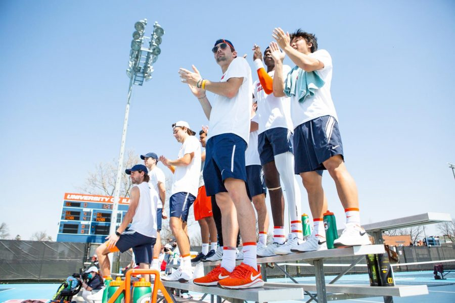 The+Illinois+men%27s+tennis+team+cheers+on+their+teammates+from+the+bleachers+in+their+singles+matches+against+Minnesota+on+Sunday+at+Atkins+Tennis+Center.+Illinois+athletics+teams+have+been+working+hard+to+beat+their+competition+this+season.