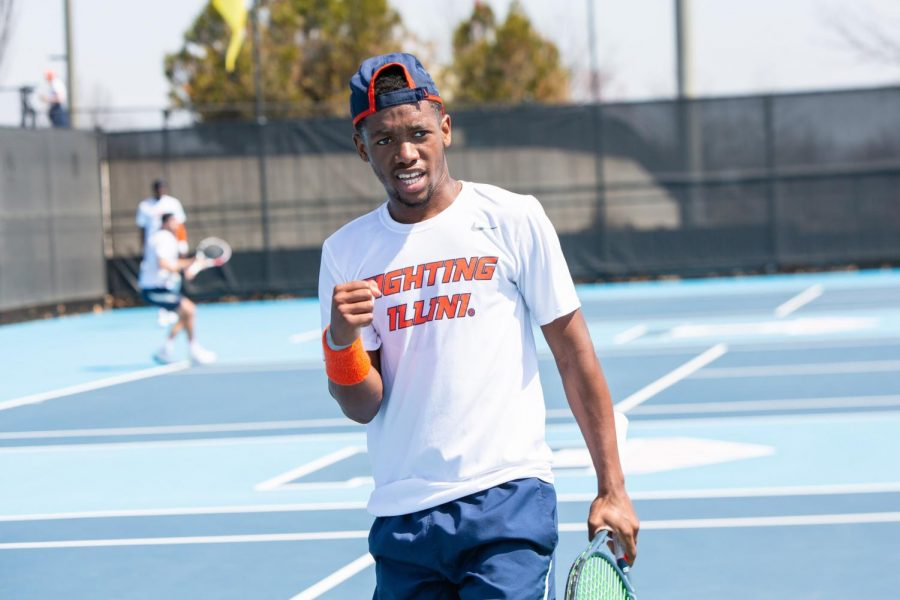 Redshirt sophomore Siphosothando Montsi celebrates during the match against Minnesota April 4 at Atkins Tennis Center. Montsi, along with seniors Aleks Kovacevic and Zeke Clark, were named to the All-Big Ten First Team Tuesday afternoon.