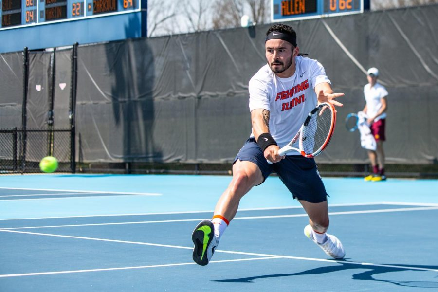 Senior Noe Khlif lunges to hit a ball in a singles match against Minnesota on April 4. The Illinois men's tennis team will travel to Evanston, Illinois on Sunday to play  Northwestern and hope to continue their winning streak.