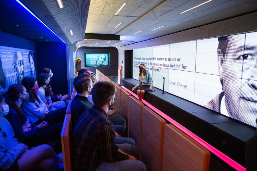 University students listen to speakers in the Mobile Museum of Tolerance on April 12.