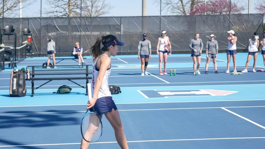 Senior Emilee Duong finishes up a match against Michigan State April 9 at Atkins Tennis Center. The team prepares to take on Purdue in the Big Ten tournament Thursday.