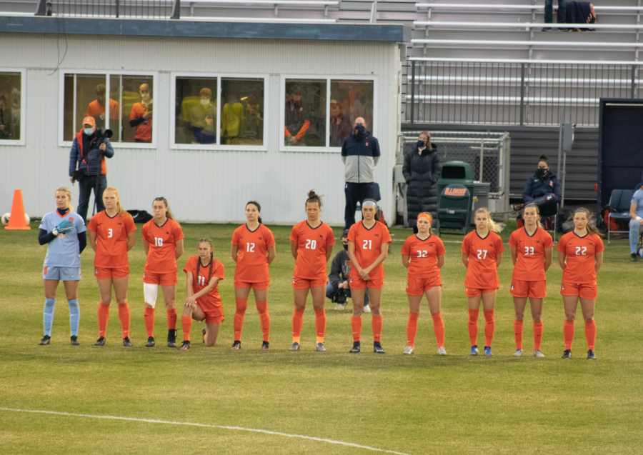 The Illinois soccer team lines up for the national anthem before the game against Iowa Thursday night. The Illini fell to the Hawkeyes 2-1, knocking them out of the Big Ten Tournament.