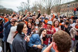 A group of University students crowd around a videographer on the Main Quad after the Illini basketball team won the Big Ten Championship on March 14. Columnist Nick Johnson argues that Illini basketball fans shouldn't be worried for next season because Brad Underwood is prepared to build another winning team.