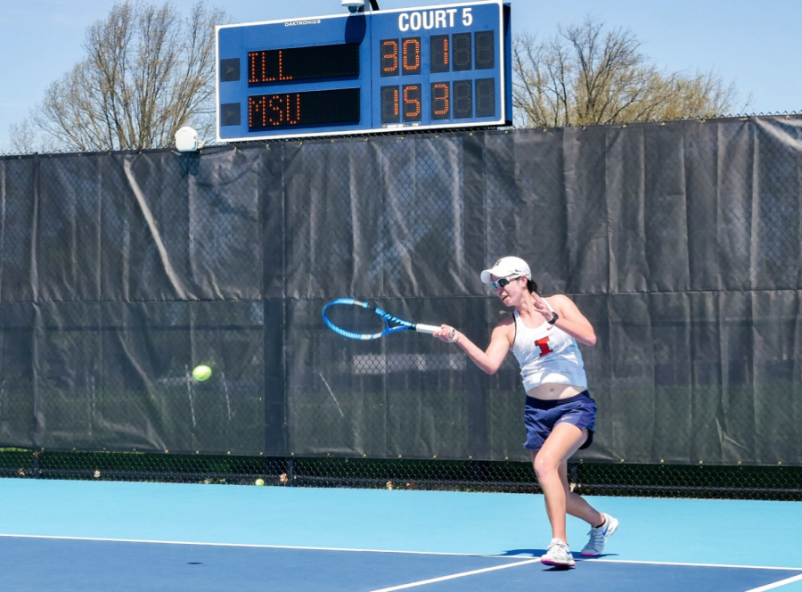 Freshman Kate Duong hits a ball during a match against Michigan State on April 9. The Illinois women's tennis team will play their final match of the regular season on Sunday against Northwestern at Atkins Tennis Center.