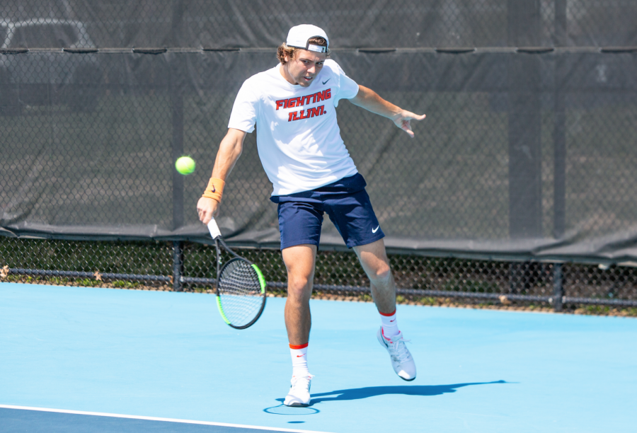 Senior Aleks Kovacevic hits a ball during his singles match against Minnesota on April 4 at Atkins Tennis Center. Kovacevic played extremely well during the Illini men's tennis match against Indiana this weekend where team won 4-0.