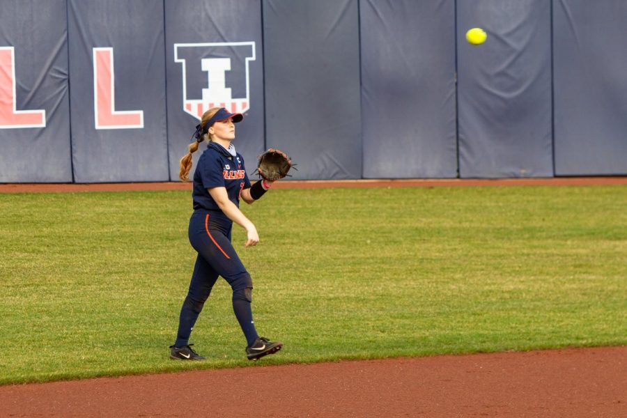 Junior Avrey Stiener catches the ball during their game against Minnesota on March 28. The team may have placed fourth, but they continue to improve their skills individually.