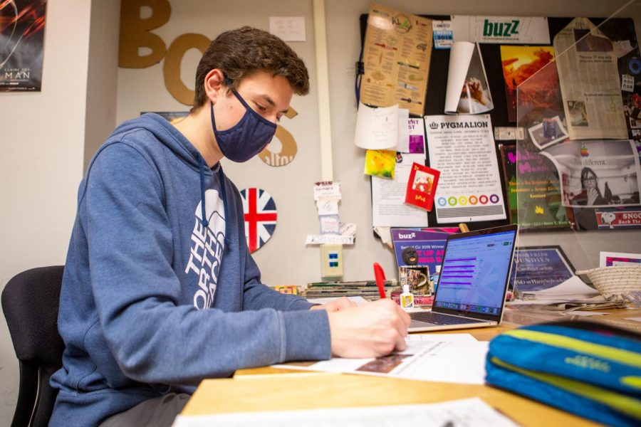 The Daily Illini Opinions Editor Nathaniel Langley makes edits on the Graduation Guide on Saturday. In presenting one's voice, the world is exposed to fresh concepts administered by its succeeding generation, Langley writes.
