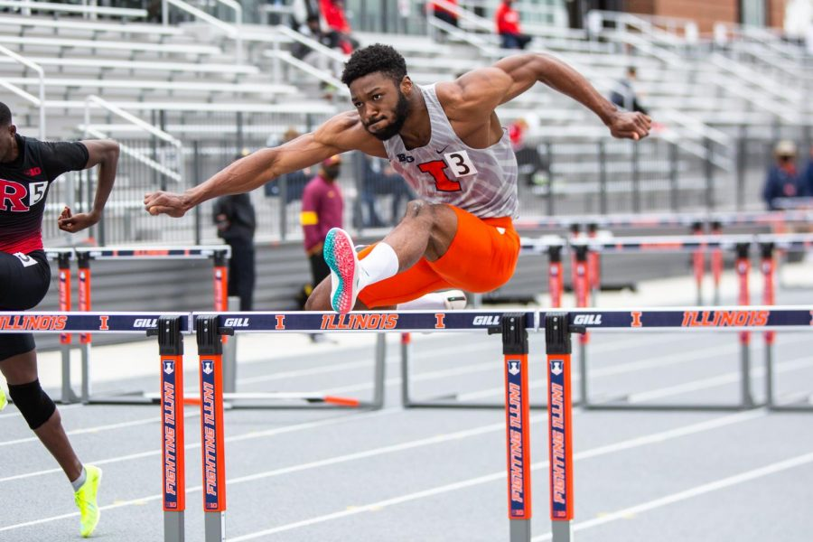 Graduate student Jonathan Wells competes in the 100m hurdles at the Fighting Illini Big Ten Relays on April 23. The Illinois track and field team will head to Minnesota and Indiana for their final regular-season meets.