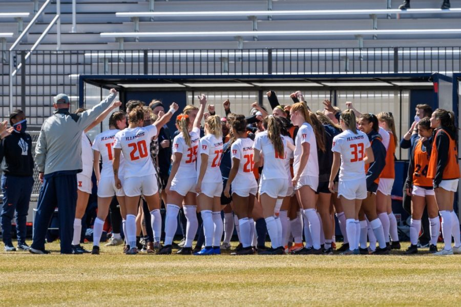 Fighting Illini Athletics Members of the Illinois women's soccer team huddle up on the sideline during the game against Ohio State March 21. The team finished the regular season with a 6-4-1 record.