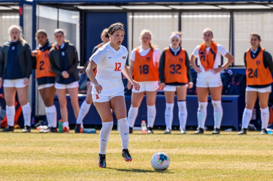 Redshirt sophomore Kendra Pasquale looks for an opportunity to pass the ball during the game against Ohio State on March 21. Pasquale scored the winning goal against Northwestern today in Evanston, Illinois.