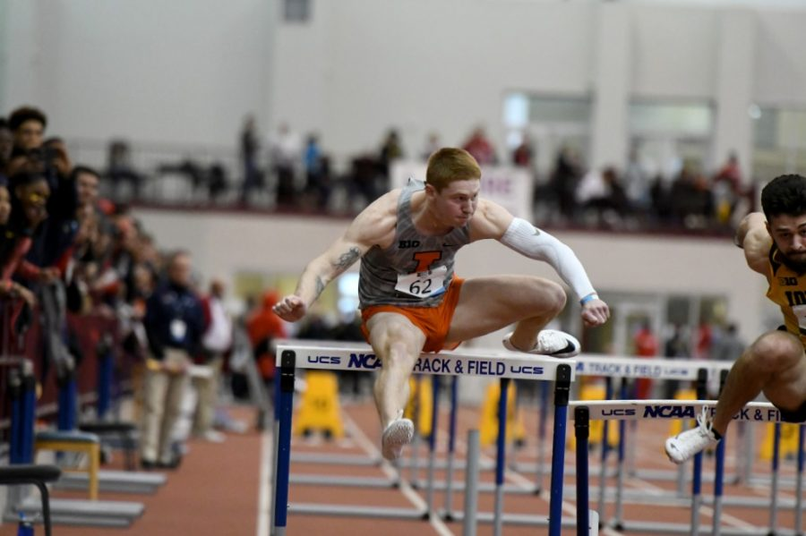 Junior Bret Dannis jumps over a hurdle at their meet on Feb. 21. The team will have their next meet in Champaign on Friday.