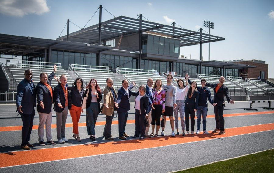Part of the Demirjian family along with other donors pose for a photo in front of the bleachers at Demirjian Park on Tuesday. The newly constructed park will serve as home to the Illini track & field and soccer programs.