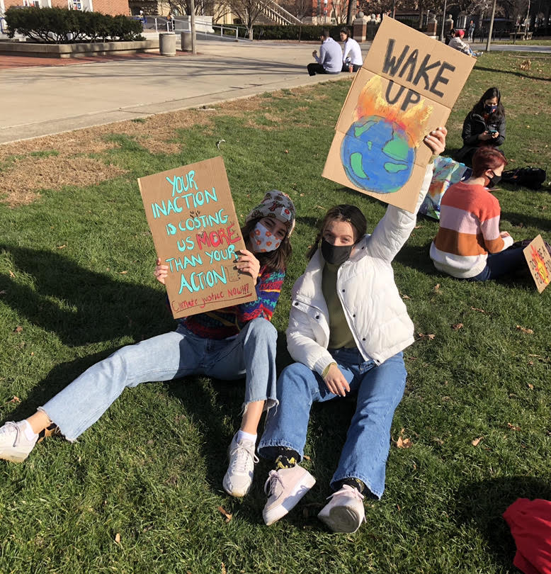 Shallon Malfeo and Nicole Muczynska pose for a photo at the SECS Climate Strike last fall. The Universities Students For Environmental Concerns group will host Earth Week events from April 17 to April 23.