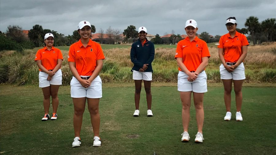 The Illinois women's golf team poses for a photo on a golf green. The team will be traveling to Maineville, Ohio in just a few days for the Big Ten Championship.