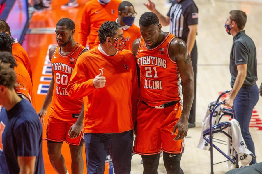 Illinois assistant coach Orlando Antigua (left) talks to Kofi Cockburn during the game against Penn State Jan. 19 at State Farm Center. Antigua has been rumored to be leaving Champaign for Kentucky.