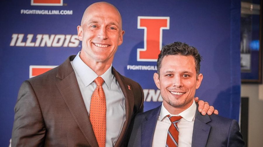 Athletic director Josh Whitman (left) poses with new head wrestling coach Mike Poeta at a press conference Thursday. Poeta takes over for recently retired coach Jim Heffernan.