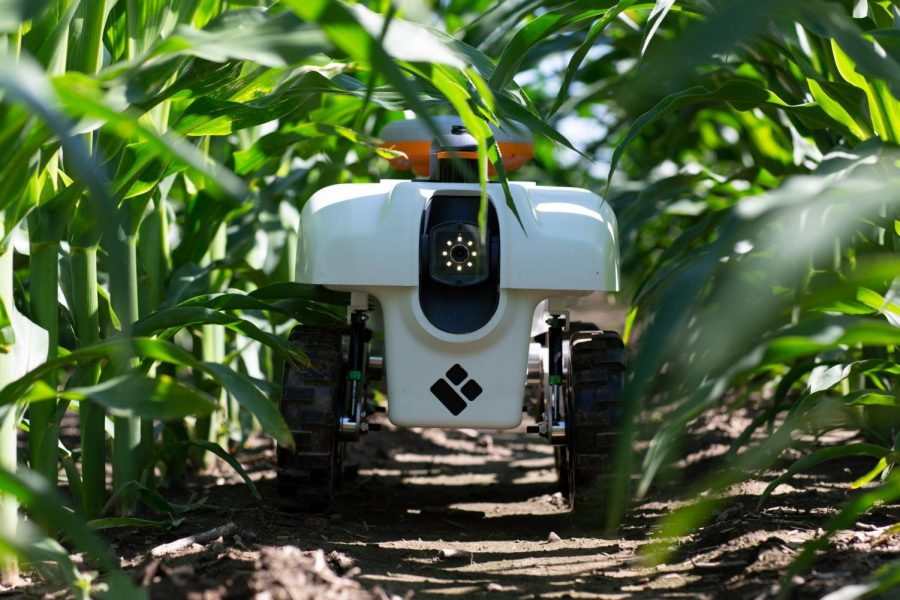 Dr. Girish Chowdharys autonomous agriculture robot roams through a field of crops. Chowdhary and students at the University have developed robots to mimic games of capture the flag.
