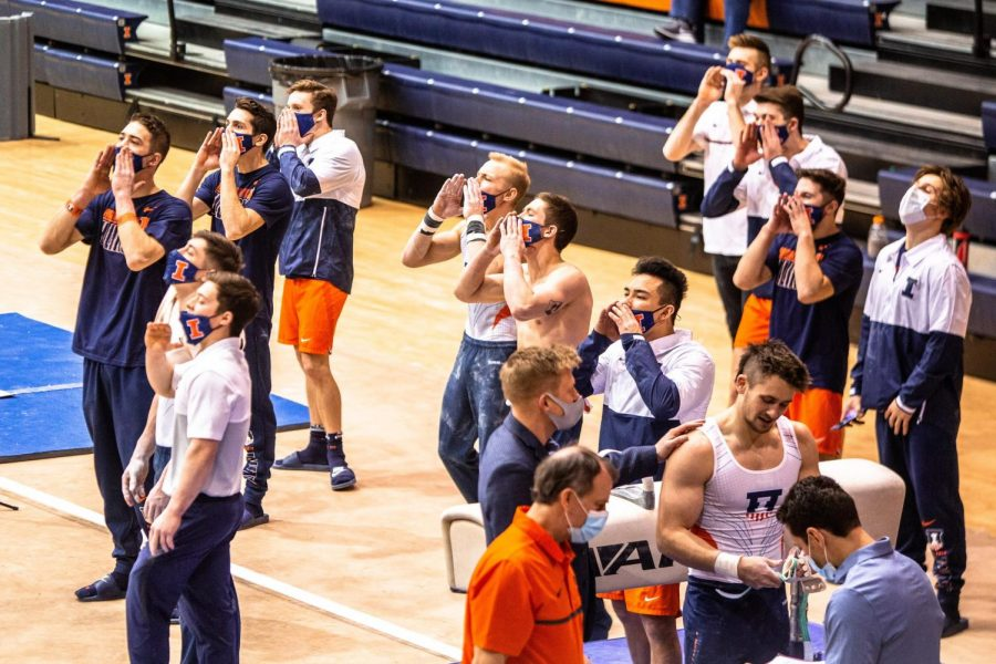 The+men%E2%80%99s+gymnastics+team+cheers+during+the+meet+against+Ohio+State+Jan.+23+at+Huff+Hall+in+Champaign.+The+Illini+had+injury+issues+all+year%2C+though+they+still+had+several+individual+accolades+throughout+the+season.%0A
