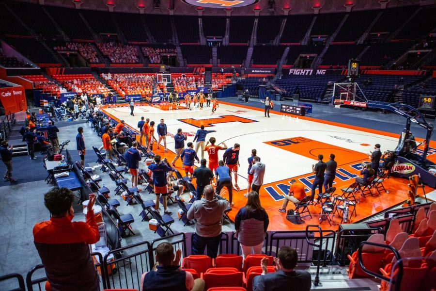 The Illinois basketball team celebrates a win against Iowa Jan. 29. Brad Underwood will still have some key players for the fall.