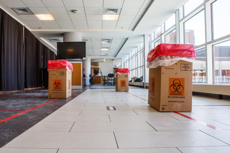 Biohazard waste bins line the ARC Covid-19 testing center on Feb. 1. The University is decreasing the number of testing sites around campus and will require less testing during the summer for students, faculty, and staff.
