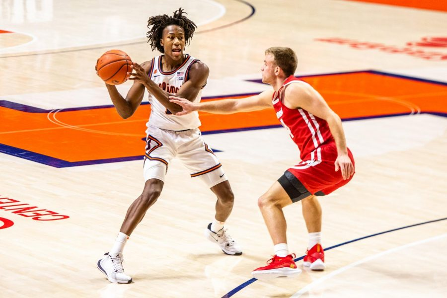 Junior Ayo Dosunmu looks for an open pass opportunity at the game against Wisconsin Feb. 6. The Daily Illini named Dosunmu the best men's player of the year.